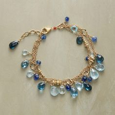 "BLUE HORIZONS BRACELET -- Thoi Vo strings double strands of 14kt gold filled with blues from translucent aquamarines to intense London Blue topaz and deep kyanite. Lobster clasp. Handmade in USA. 7"" to 8""L."