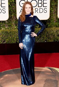 Julianne Moore waers a dark blue Tom Ford sequin dress with Chopard jewelry.