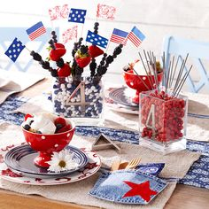 Make an edible centerpiece with holiday-color candies and fresh berries on skewers. More 4th of July ideas: http://www.bhg.com/holidays/july-4th/?socsrc=bhgpin062112
