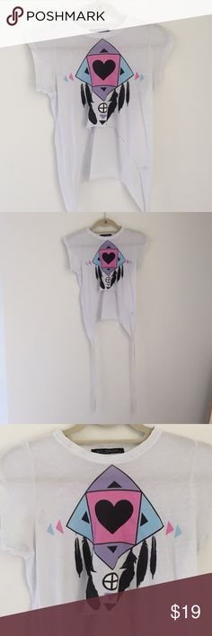 Wildfox Couture festival shirt size SMALL Perfect for day or festival season! Super fun Wildfox shirt with a long side fringe on each side. Boho design in center of the shirt. Sits as a crop top and very flattering. Runs true to size. Small stain on right shoulder that can easily be cleaned. Purchased for $95. Worn twice. Wildfox Tops Crop Tops