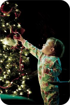 """""""Christmas through the eyes of a child"""" ~ photographed on November 1, 2009 by Jana's Creations:  a 17-month old in awe of the Christmas tree..."""