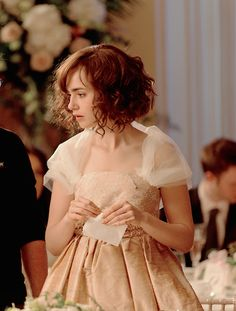 Lily Collins. If I get my hair chopped into a bob, I kind of want to curl the BEJESUS out of it.