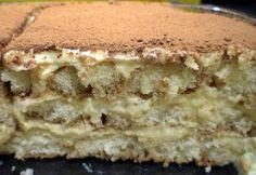 The perfect Tiramisu is a balance of flavors of a sweet zabaglione, strong coffee, marsala wine, creamy mascarpone cheese and the dusting of cocoa.
