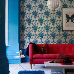 Indigo walls with red sofa