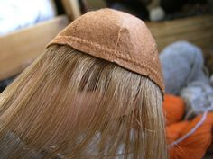 how to tutorial for sewing wefts to a felt cap.