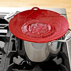 Want . . . how cool is this! Kuhn Rikon Spill Stopper #WilliamsSonoma