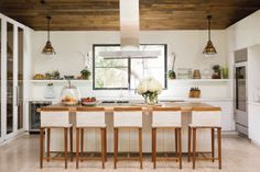 In the kitchen, vintage light fixtures from Obsolete and counter stools by furniture maker Doug McCollough, brother of Proenza Schouler fashion designer Jack.