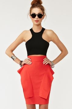 "Summer is looking Good  Another ""Peplum"" skirt w great details. Those pockets, LOVE the way they elongate the skirt & U. Midriff tops r going to be shown every where ! If the thought of it puts u in a cold sweat, raid your closet !!! Bet there's at least 2-3, (or more), ""Great Cover Me Up, Just a Bit"" pcs. From a light, roll up the sleeves, shrunken Blazer......to that Funky, Vintage inspired Jkt u bought yrs ok, just knowing it would come in handy 1 day. Your Style,your choice."