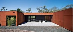 A protected, paved courtyard on the western edge.    House by Judd Lysenko Marshall Architects in the scrub of Smokey Town, near Ballarat.