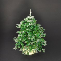 Miniature beaded Christmas tree - green and with ice on branches - great festive home decoration. €25.00, via Etsy.