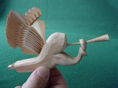 """""""Angel Gabriel with Horn"""" made by Sally Nye from one piece of wood (1/2 by 2 by 6 inches). Our wood of choice is white cedar that is found in the northern regions of the U.S.A. In central Europe, fir and spruce are preferred. Pine and aspen are favored in Scandinavia. If you have wood in your region that is straight-grained and long-fibered …give it a try. Fan carving is considered an entry-level to woodcarving. It is not complicated, and it is fun to do! White Cedar, Wooden Bird, Central Europe, Old World, Horns, Folk Art, Fan, Entry Level, Woodcarving"""