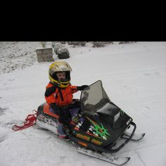 CJ's first snowmobile! 2011