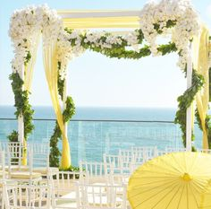 Yellow, green, and white chuppah by White Lilac
