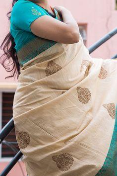 A gorgeous cream Pure banaras silk with zari buttas and double sided zari border and turquoise blue zari pallu. Rich golden zari pallu with attached blouse