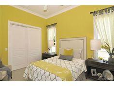 Mustard yellow and gray kids room - teen room.  Fairgrove |  Talis Park in Naples, FL www.ihnaples.com