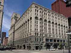Dankmar Adler and Louis Sullivan The Auditorium Building, 1886–9, Chicago   By combining Richardson's vertical hierarchy with Burnham and Root's elimination of the wall, Adler and Sullivan were able to achieve in this building some measure of balance between classical monumentality and the expression of modern structure.
