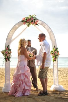 The Jeffries' destination wedding at Riu Palace Tropical Bay in Jamaica. Gorgeous pink wedding dress, beach ceremony, and wedding arch!