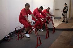 Brazilian Inmates pedal stationary bikes at a prison in Santa Rita do Sapucai, Brazil to power a town with electricity