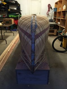 The outer stem tied down with surgical tubing like Gulliver by the Lilliputians:) Canoe Boat, Canoe And Kayak, Boat Shelf, Wood Boats, Small Boats, Kayaking, Canoeing, Boat Plans, Boat Building