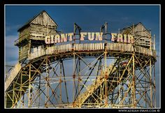 Derelict Fun Fair - Rhyl, Wales  I remember driving past this every time we went on holiday  and hopeing one day i would be tall enough to go on the rides the land where it was is completely flat now :'(
