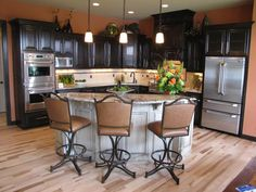 Great layout. Want the black cabinets, gray walls, river white granite and black barstools with black/gray and white cowhide.