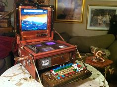 Lady Victoria is a Steampunk computer, built from the work bench up.  Every tiny piece was hand crafted, including the keyboard and mouse.  She is fully loaded with windows 8 and and wifi.  She weighs an absolute ton... So much for being portable.
