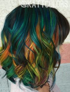 Absolutely love this green orange Teal dyed hair color inspiration