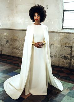 Soalnge Knowles wore a caped gown by Leon for Kenzo in her wedding photos // minimalist