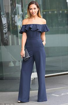 Raising the bar-dot: Myleene Klass looked sensational in an off-the-shoulder navy jumpsuit for theCEW beauty awards on behalf of Global Radio in London on Friday