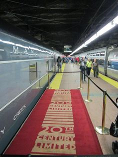 "A section of one of the famous red carpets, next to the observation car ""Hickory Creek"". The 20th Century Limited originally departed New York City from the right-hand side of this platform."