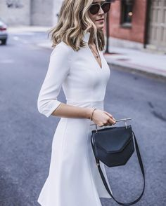 Easily replicated, since this blogger didn't let us know Who designed this dress. But it's an easy one to pick up. This is perfect for working 9-to-5 through the summer with air-conditioning