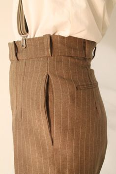 *Fabric used for these trousers is dark brown wool. See last picture for fabric* These high waisted pants are made in beautiful 100% wool after an original late 1930s pattern. These high waisted pants, or jitterbug pants were worn by dancers and musicians. They can be worn either with a belt or with braces or suspenders. There is a small watch pocket at the front, side pockets, and two double welt pockets at the back. The hem is finished with a nice fold. Overall the pants are nicely…