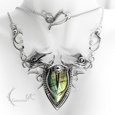DRACTNAR - silver and labradorite. by LUNARIEEN elf elven necklace amulet pendant equipment gear magic item | Create your own roleplaying game material w/ RPG Bard: www.rpgbard.com | Writing inspiration for Dungeons and Dragons DND D&D Pathfinder PFRPG Warhammer 40k Star Wars Shadowrun Call of Cthulhu Lord of the Rings LoTR + d20 fantasy science fiction scifi horror design | Not Trusty Sword art: click artwork for source