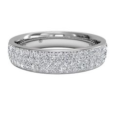 At 4 mm wide, this women's triple micropave diamond wedding band is a classic style. Set closely for three rows of sparkle, diamonds are enhanced by 18kt white gold.