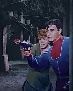 Colorized picture of June Lockhart and Guy Williams as Maureen and John Robinson.