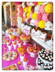Colorful dessert table at a donut birthday party! See more party planning ideas at CatchMyParty.com!