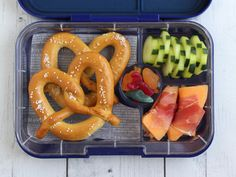 soft pretzels, sliced cucumbers, melon wrapped with prosciutto (regular ham works too) and a few gummies
