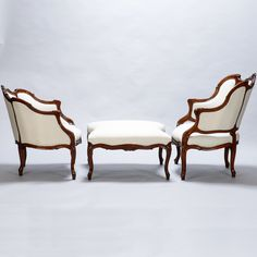 19th Century Duchesse Brisee Avec Tabouret  --  Classic French furniture trio consisting of two armchairs and coordinating stool or bench dating from mid 19th century.  The curved edges of the matching stool is designed to allow for a cozy seating arrangement when the three pieces are nestled again.  --   Item:  7316  --  Retail Price:   $4895