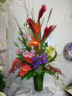 "Since Vickies Flowers is an independent florist we have the freedom to leave the ordinary ""cookie cutter"" arrangements to franchises and box stores and offer ikebana and creative designs translating literally to ""living flowers,"" Ikebana is an ancient and magnificent Japanese floral arrangement technique."