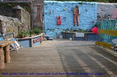 Like the raised beds which could also act as seating. Decking laid width ways too.