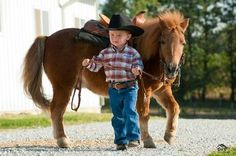 A cute little cowboy and his pony. what a sweet and beautiful pair Little Cowboy, Cowboy Up, Cowboy And Cowgirl, Cowboy Humor, Cowgirl Quote, Cowboy Hats, Horse Pictures, Cute Pictures, Magical Pictures