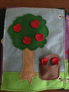 Quiet Book #10: Apple Tree.  So simple but really easy for little hands. No velcro or snaps.