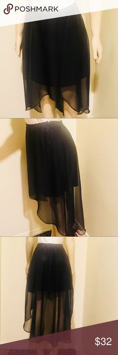 Bisou Bisou High-Low Sheer Skirt over Mini Versatile Little Black Skirt with Sheer High-Low Shell. Fancy with a Formal Blouse or cute with a sexy top.  Bisou Bisou French Style.  Zipper up the Back. New Condition  Bundle 10% Off 2 items in my closet              15% Off 3 or more  ⭐️⭐️⭐️⭐️⭐️ Rated  Posh Ambassador I Mail Daily✈️ Bisou Bisou Skirts