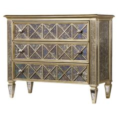 Add a gleaming touch your living room or master suite with this 3-drawer dresser, featuring an antiqued mirror finish and gold-hued trimming.  ...