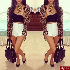 Leopard cardigan, high waisted white shorts and black flats.