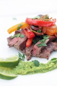 #paleo Steak Fajitas: 1 lb Skirt Steak; 1 tsp Black Pepper; 1 Red Bell Pepper, seeded, and thinly sliced; 1 Tbsp Coconut Oil, Organic; 1 tsp Chipotle Powder; 1 tsp Cumin; 4 cloves Garlic, minced; 1 Yellow Bell Pepper, seeded, and thinly sliced; 1 Vidalia Onion, thinly sliced; 2 cup Baby Bella Mushrooms, sliced; 1 tsp Salt; ⅛ cup Lime Juice