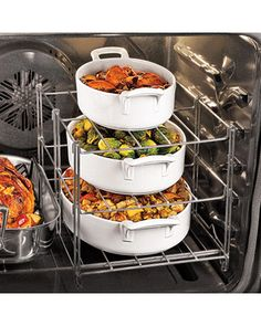 Multi-Tier Oven Rack from Sur la Table .perfect for dinner parties Who doen't need this? - if next oven doesn't have two racks and dishes fit side by side. My current oven fits four dishes just fine. Kitchen Hacks, Kitchen Tools, Kitchen Gadgets, Kitchen Dining, Kitchen Utensils, Kitchen Products, Kitchen Things, Kitchen Art, Kitchen Stuff