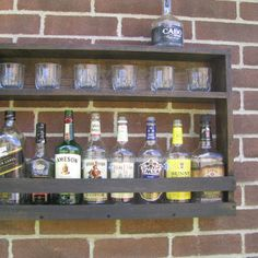 Hanging Liquor Cabinet - Rustic Liquor Rack with Glass Storage - Rustic Hanging Liquor Cabinet from CoolAndUsefulThings on Etsy. Liquor Shots, Liquor Bar, Wine And Liquor, Alcohol Storage, Liquor Storage, Alcohol Cabinet, Liquor Cabinet, Bar Shelves, Display Shelves