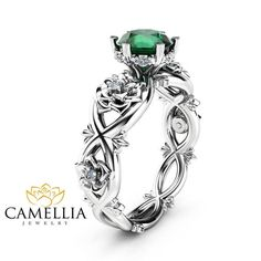 Stunning feminine and breathtaking! This natural emerald halo engagement ring is crafted in solid 14k white tone gold with a 1 ct round shaped natural green emerald, beautiful shiny stone, full of luster and brilliance. Set into a gorgeous floral ring. The timeless and unique design of this floral ring will make your engagement unforgettable.   SETTING #SKU: CJ-0004-1816B Metal: 14K White Gold (Available Also in 14K Yellow Gold or 14K Rose Gold - No Extra Charge) Certificate: CJC (Camellia…