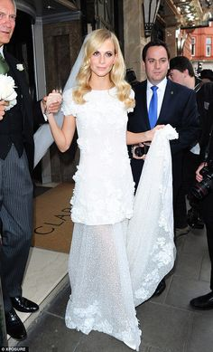 Here comes the bride: Poppy Delevingne pictured on her way to the church in her custom-made Chanel gown
